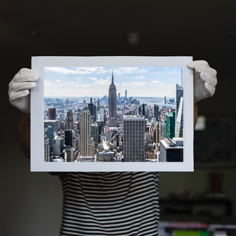 person holding an archival print