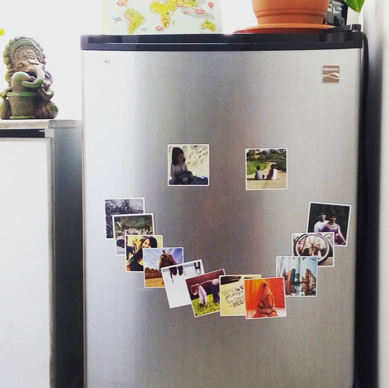 photo magnets arranged in the form of a smile