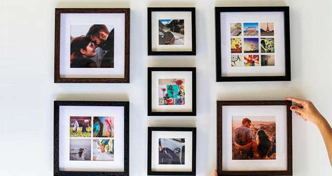 photo frames of different sizes on a table