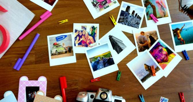 group of many polaroid style magnets on a table