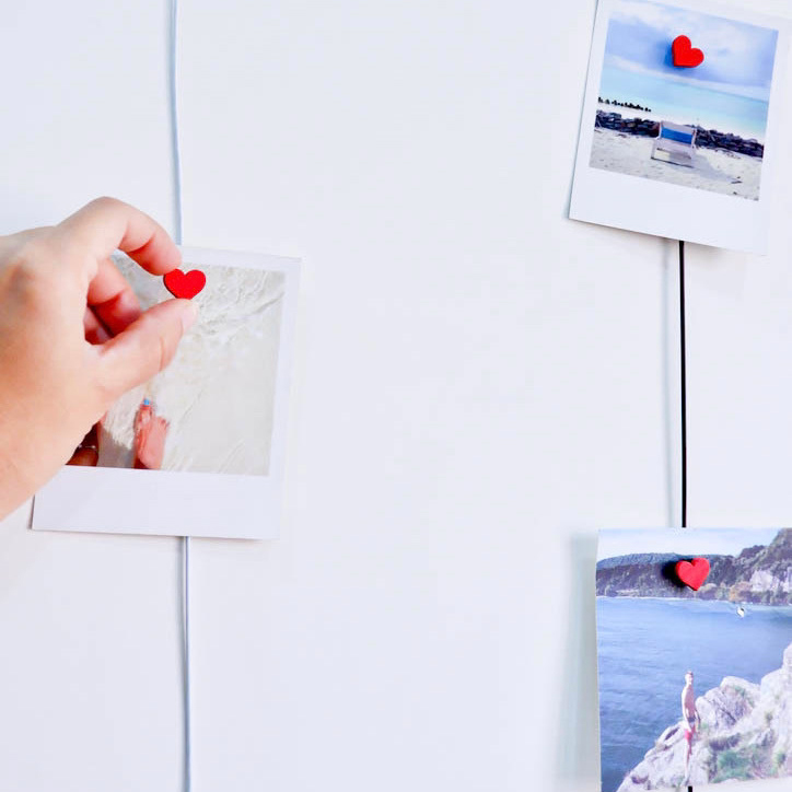 photo magnets used as decor for kitchen